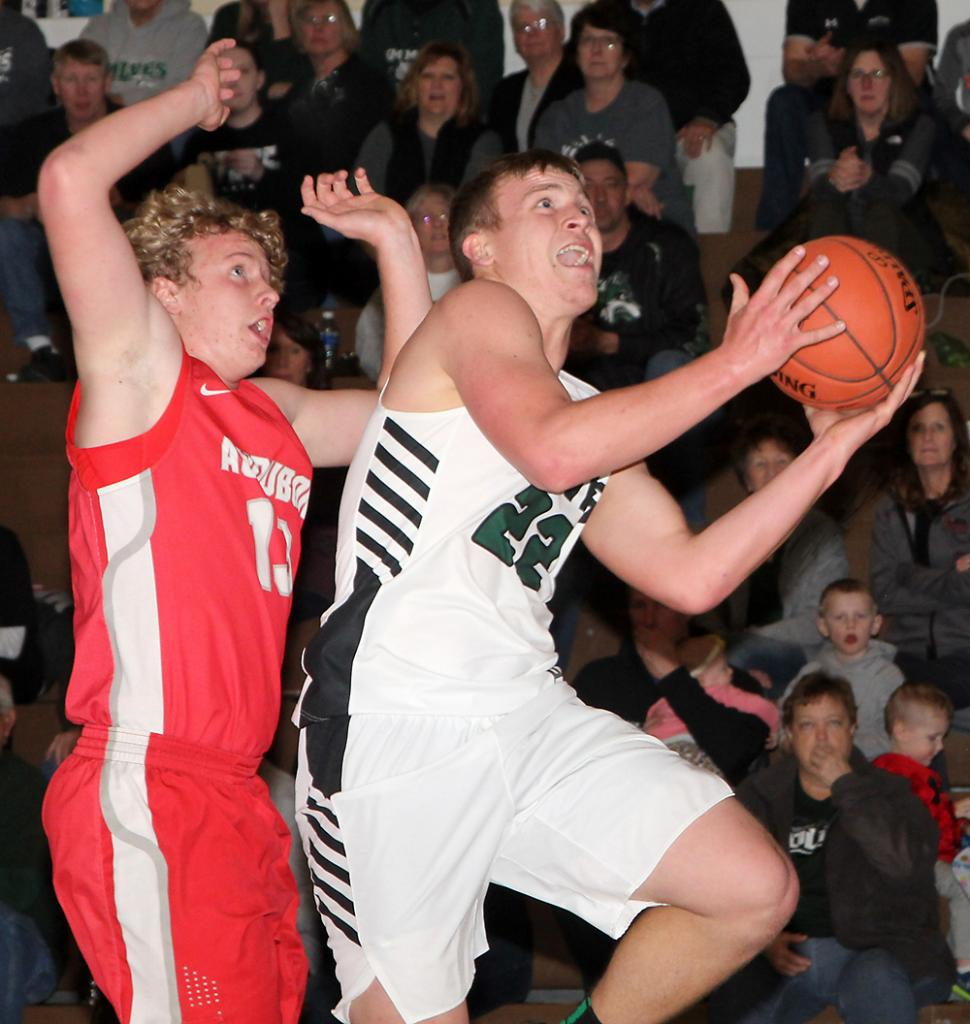 IKM-M junior Kyler Rasmussen (right) looks to score against the Wheelers.