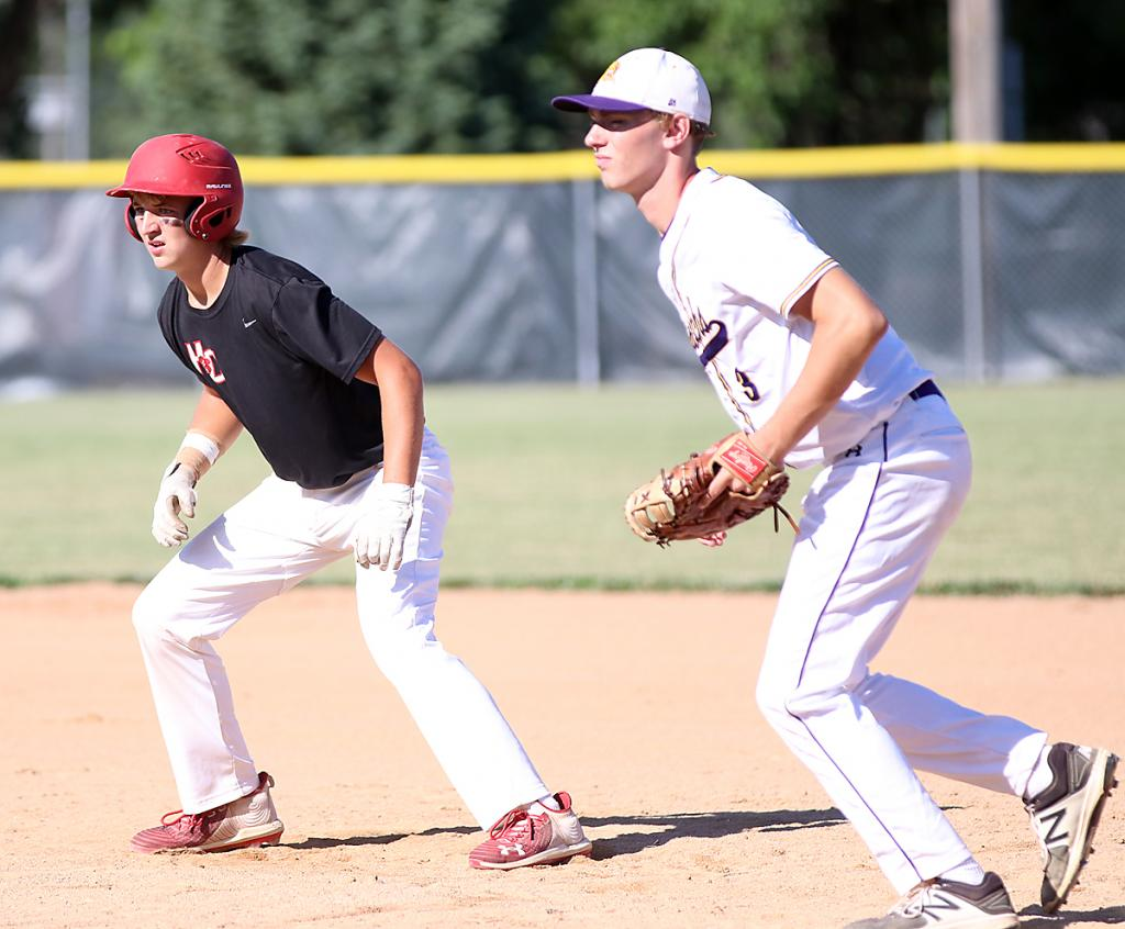 Cyclone freshman Teagon Kasperbauer (left) leads off first base, held by Monarch first baseman Braiden Heiden. (Photos by Mike Oeffner)