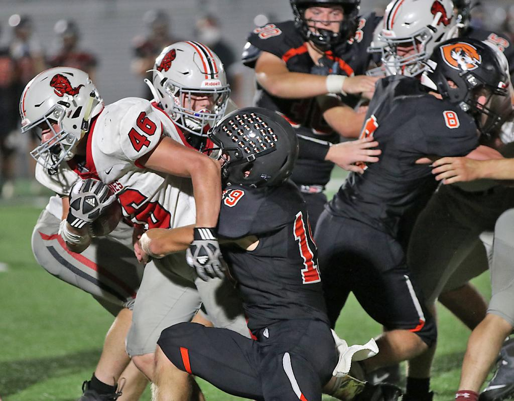 HCHS fullback William Kenkel (46) fights for some of his 49 rushing yards.