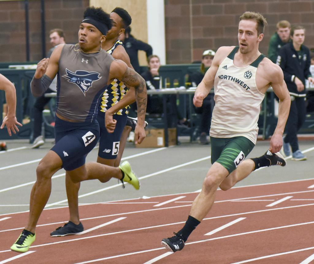 Northwest Missouri State senior Marcus Klein (right) comes off the turn in the 200-meter dash during a home indoor meet this past season. Klein qualified for NCAA Division II nationals in the long jump for the second straight season, but the meet was cancelled in March due to COVID-19. (Photo courtesy of Scott Vicker/SWCC)