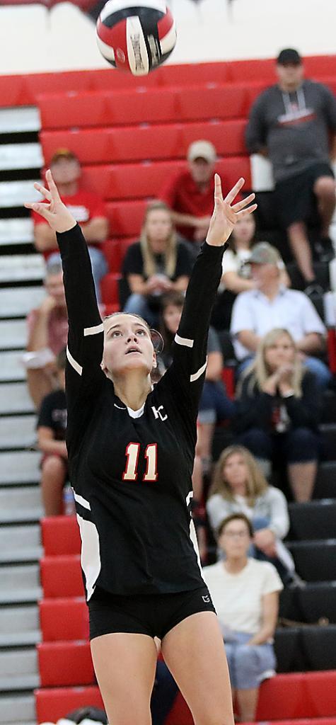 Maci Schmitz sets the ball for HCHS vs. Kuemper Catholic.