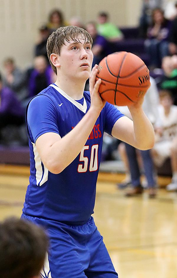 AHSTW senior Michael Mantell focuses on the rim before knocking down the second of his two game-winning free throws with :01.3 remaining last Thursday at Logan-Magnolia.