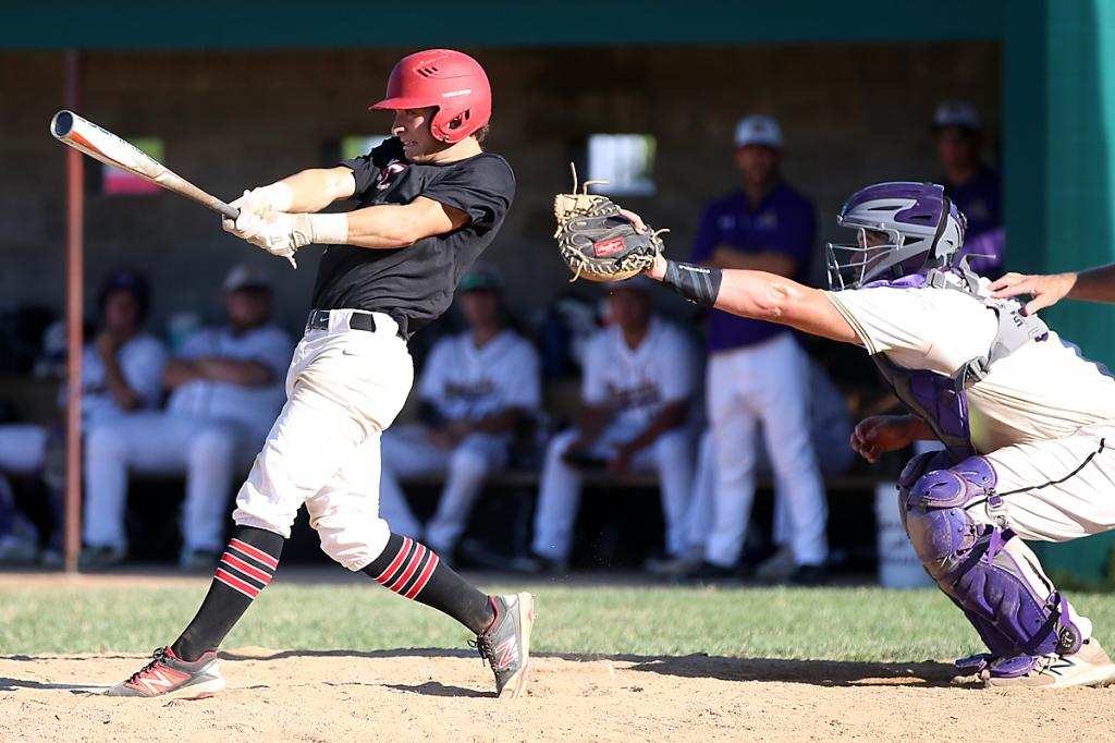 HCHS sophomore Joey Moser hits one of his three singles against Denison Monday night. Moser also scored three runs.