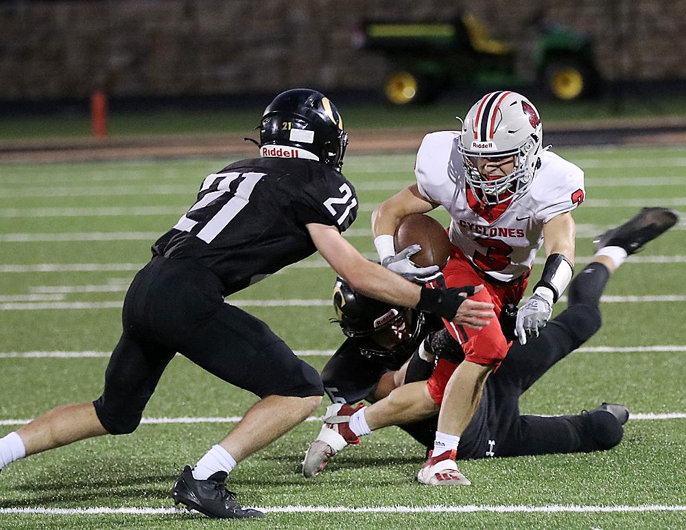 HCHS receiver Joey Moser (3) looks to break away from one Glenwood tackler and avoid Anthony Driscoll-Lee after catching a short pass against the Rams.