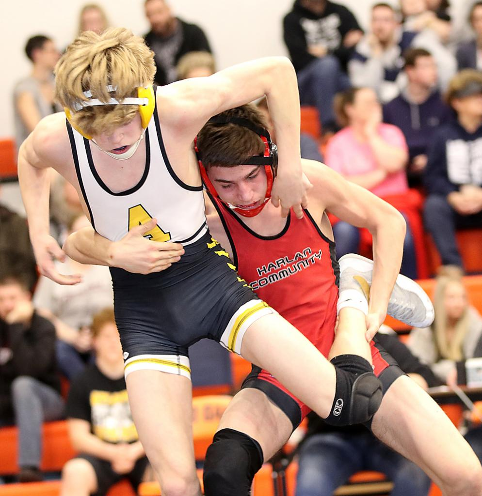 Cyclone 120-pounder Luke Musich (right) looks to take down Atlantic's Ethan Follmann in the semifinals. Musich placed second.