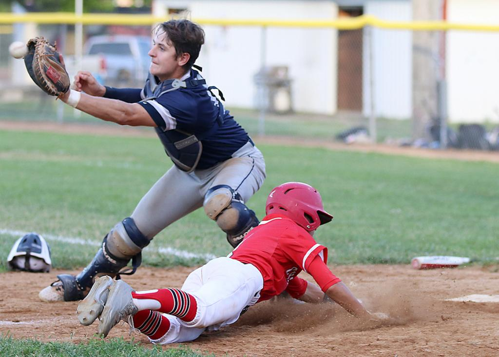 HCHS freshman Lucas Musich slides head first into home plate to score a sixth-inning run ahead of the tag by Des Moines Roosevelt catcher Mason Kochel. Musich's run pulled the Cyclones within 7-6 and they added two more in the seventh to win 8-7.