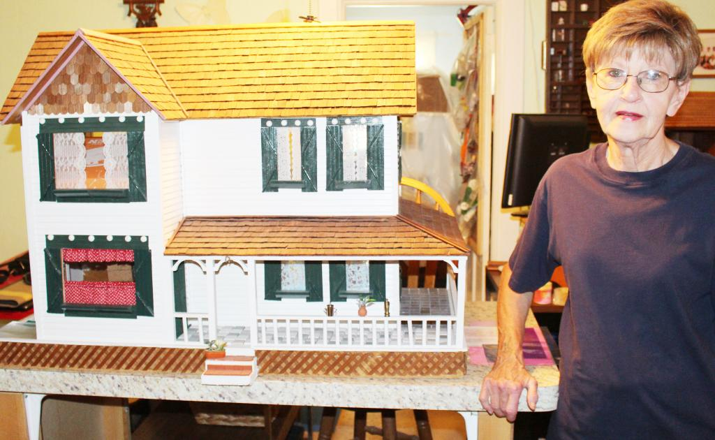 Judy Paulsen has been building doll houses for years, and received her first one after she gave a loan of $50 to someone who presented a doll house as collateral.  After her granddaughter was born, Paulsen became fascinated by doll houses, and creating new furniture or items inside the displays. (Photo by Ryan Pattee)
