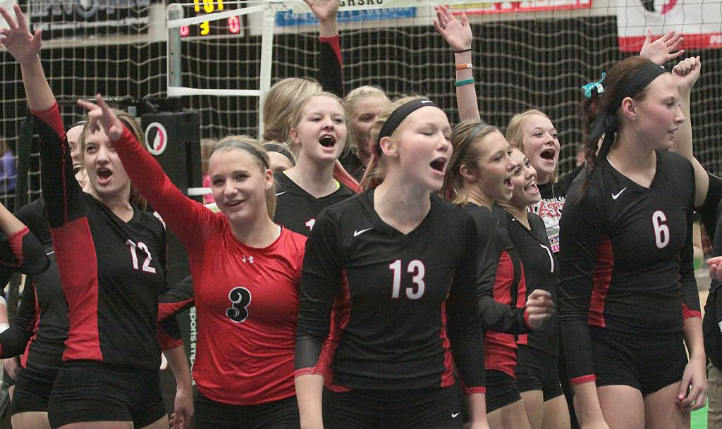 HCHS volleyball team celebrates after a three-set sweep of Pella (25-16, 25-21, 25-22) at the US Cellular Center, Cedar Rapids.
