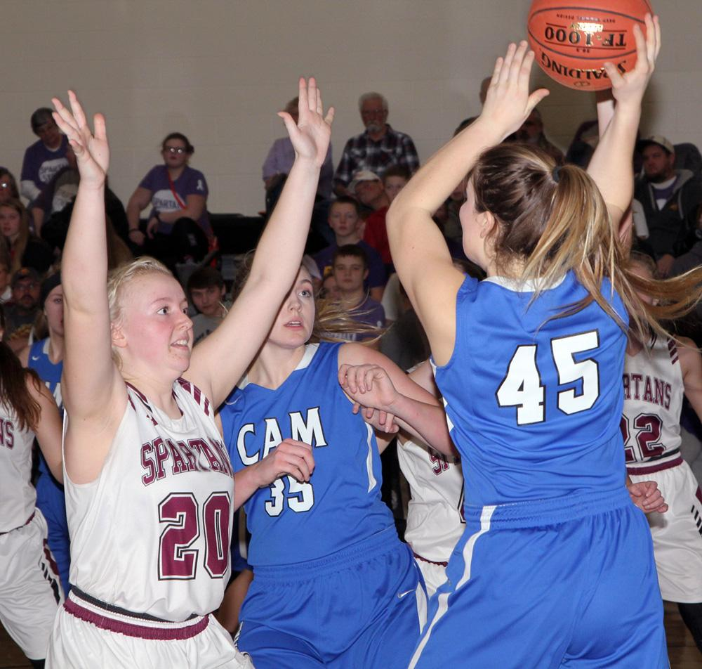 Exira-EHK freshman Mollie Rasmussen (20) guards CAM's Sammi Jahde during Monday's game.