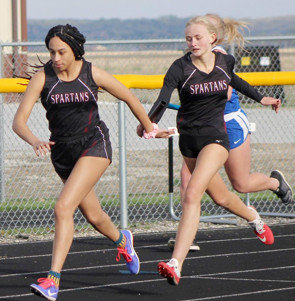 Exira-EHK's Makaela Riley (right) hands the baton to Selena Nichols as part of last year's second-place distance medley relay at the Rolling Valley Conference Meet. (Photo courtesy of Matt Gengler, Missouri Valley Times)
