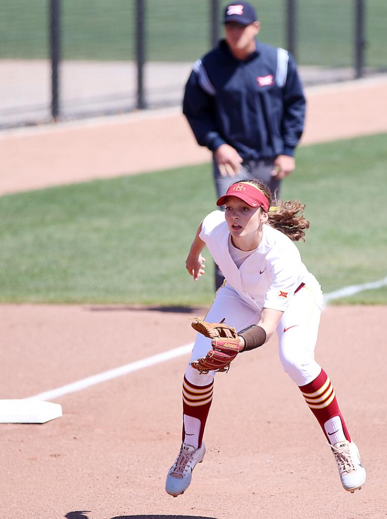 ISU's Logan Schaben hops into fielding position as a pitch is delivered against Oklahoma.