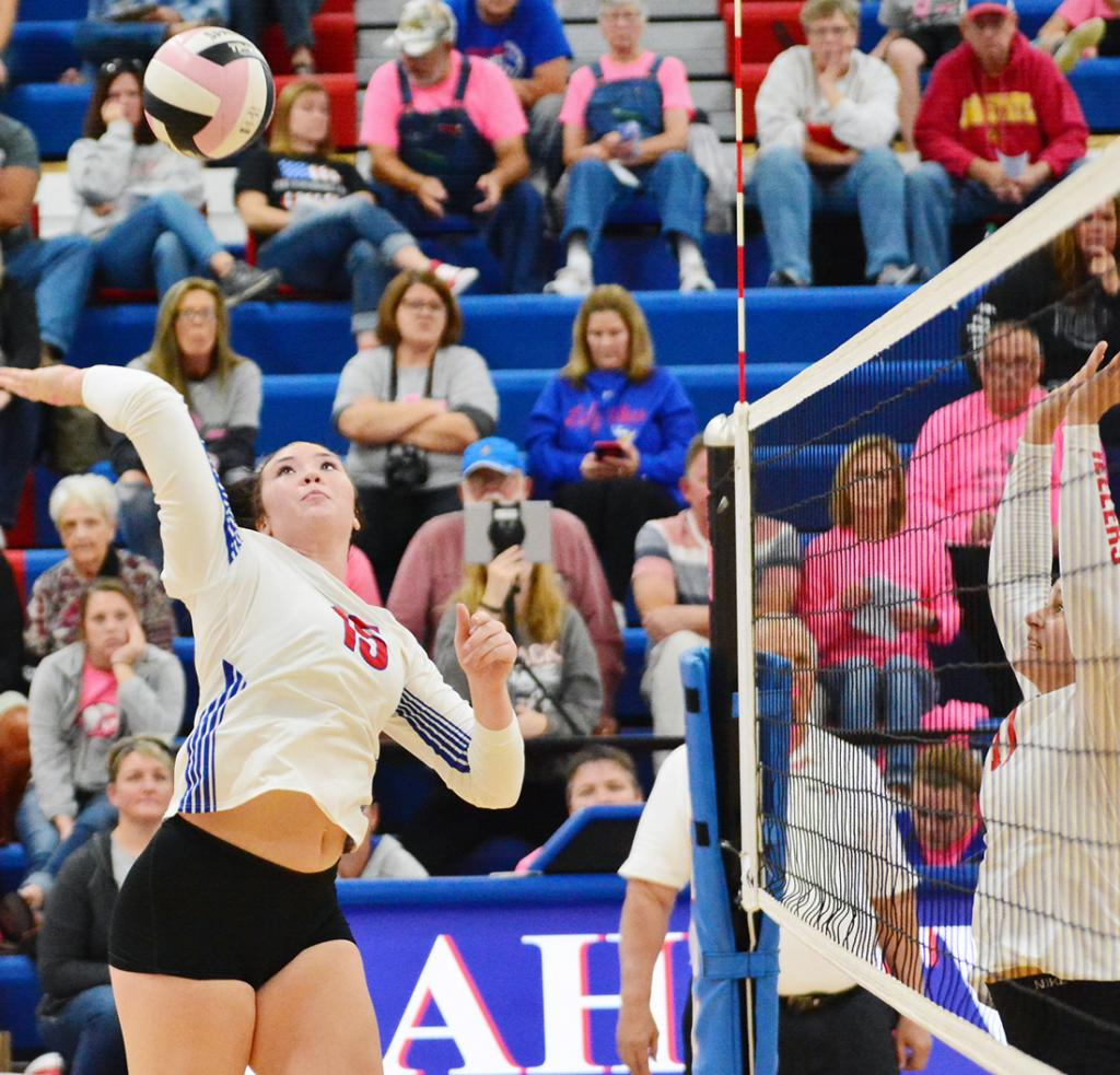 Lady Vike senior Kinsey Scheffler goes on the attack. Scheffler spiked 21 kills as AHSTW beat the Wheelers in four sets.