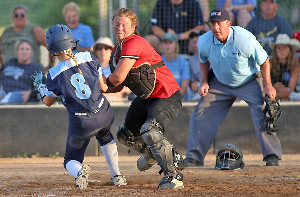 HCHS catcher Madison Schumacher tags out Lewis Central's Megan Elam at the plate to complete an F8-2 double play in the fourth inning of Saturday's Class 4A regional semifinal.