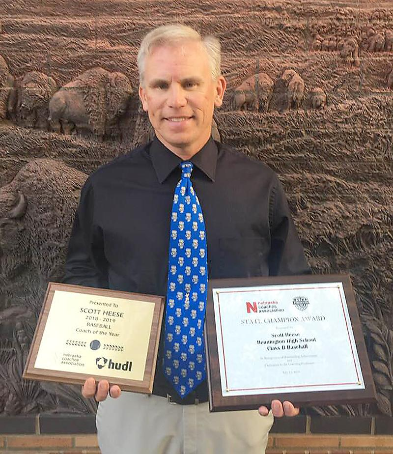 Scott Heese holds the plaque for his coach of the year honor as well as his state championship plaque for guiding the Bennington Badgers (20-5) to the Nebraska Class B state baseball title in May. (Photo contributed)