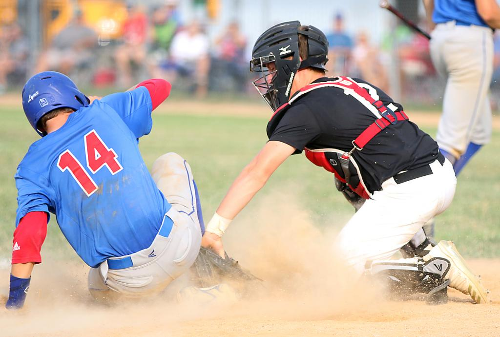 HCHS catcher Matt Sorfonden tags out AL's Nick Garner to end the fifth inning. (Photos by Mike Oeffner)