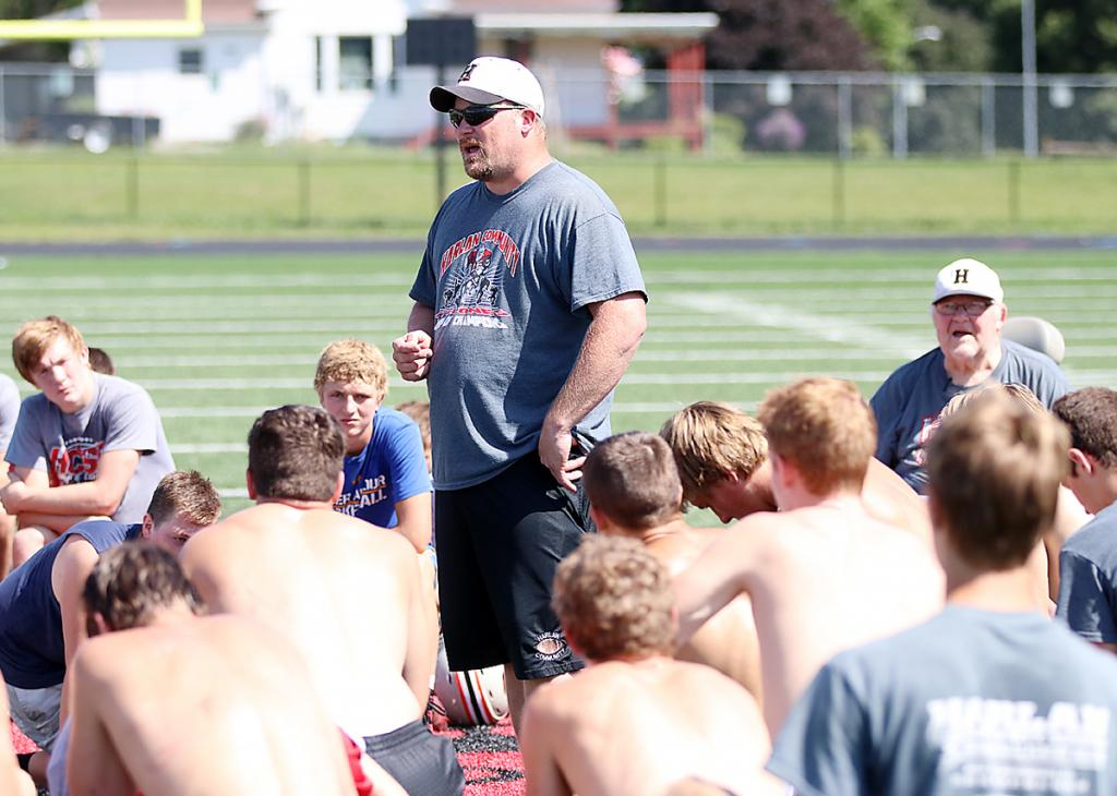 Curt Bladt's son, Todd, addresses the team following Tuesday's workout at Merrill Field. Todd Bladt will share the head coaching duties with his father during the 2019 season. (Photos by Mike Oeffner)