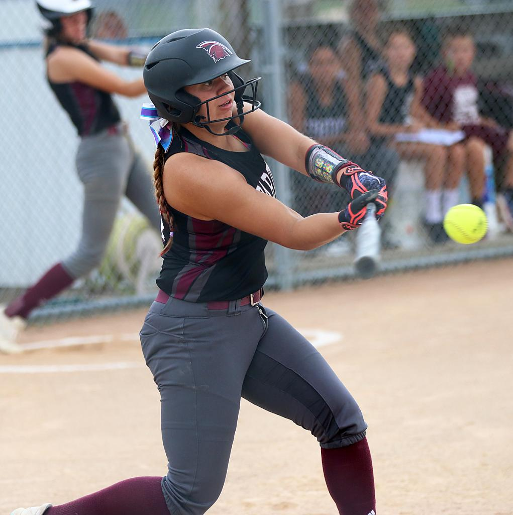 Exira-EHK junior Tatum Grubbs connects for a single in the second inning during Wednesday's regional game against Griswold. Grubbs later provided a game-winning two-run single in the bottom of the seventh.