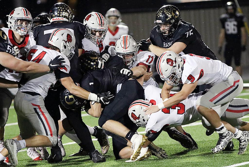 A host of Harlan Community tacklers pursue Glenwood quarterback Zach Carr (center), including Chandler Leinen (54), Allen Fries (17), Jameson Bieker (34) and Eli Monson (9). (Photos by Mike Oeffner)