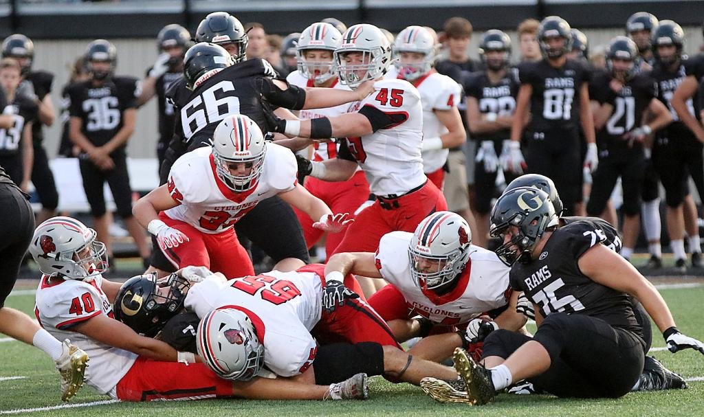 Nolan Little of Glenwood (7) is tackled by HCHS defensive ends Franz Reisz (40) and Alex Monson (65). Also pictured for the Cyclones are Jameson Bieker (right), Lucas Stanley (32) and Zane Bendorf (45).