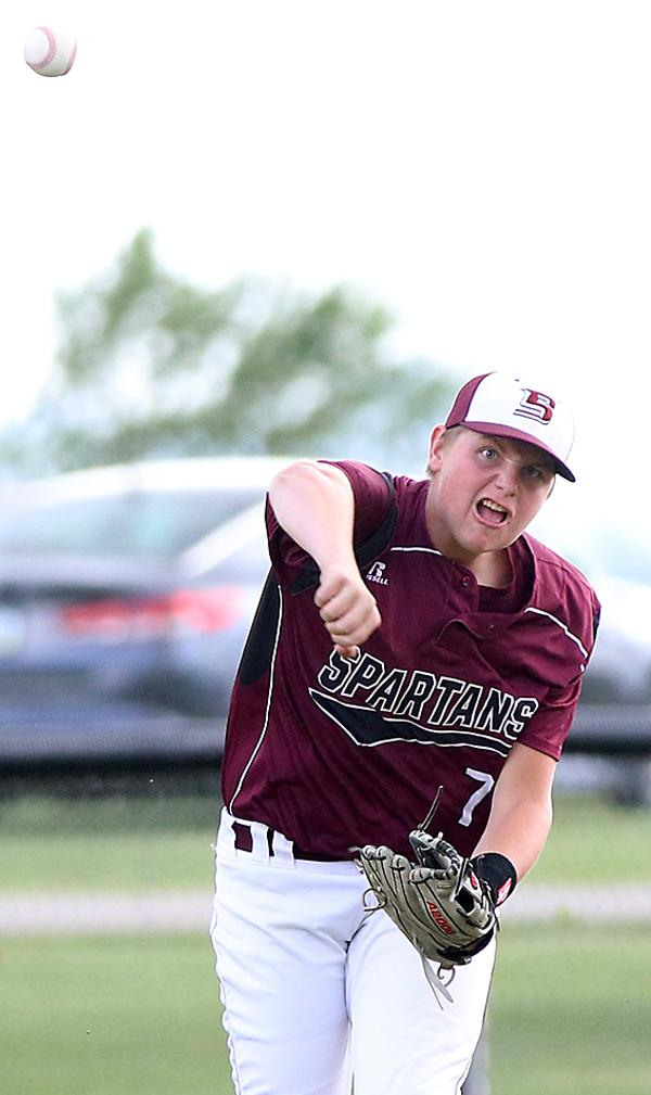 Exira-EHK's Tyler Petersen makes a throw across the diamond during conference play last season.