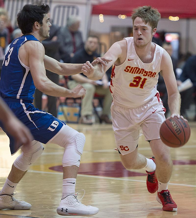 Simpson senior Kyle Wagner (right) scored 15 points per game for the 14-13 Storm this past season and finished his three-year career at the school just 51 points shy of 1,000. (Photo courtesy of Luke Behaunek, Simpson College)