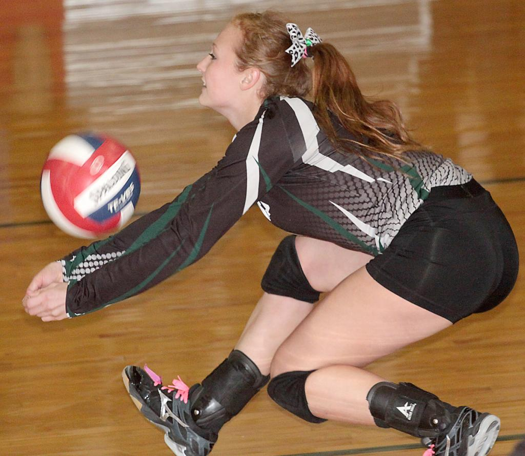IKM-Manning junior Katarina Willenborg keeps a point alive for the Wolves during Friday's regional semifinal match vs. Unity Christian. (Photo by Mike Oeffner)