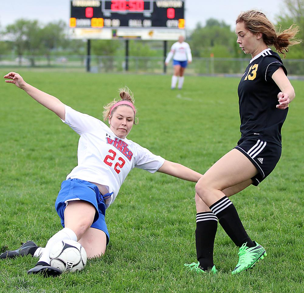 AHSTW senior Sydney Zimmerman (left) makes a slide to keep the ball in play against Tri-Center in regional play.