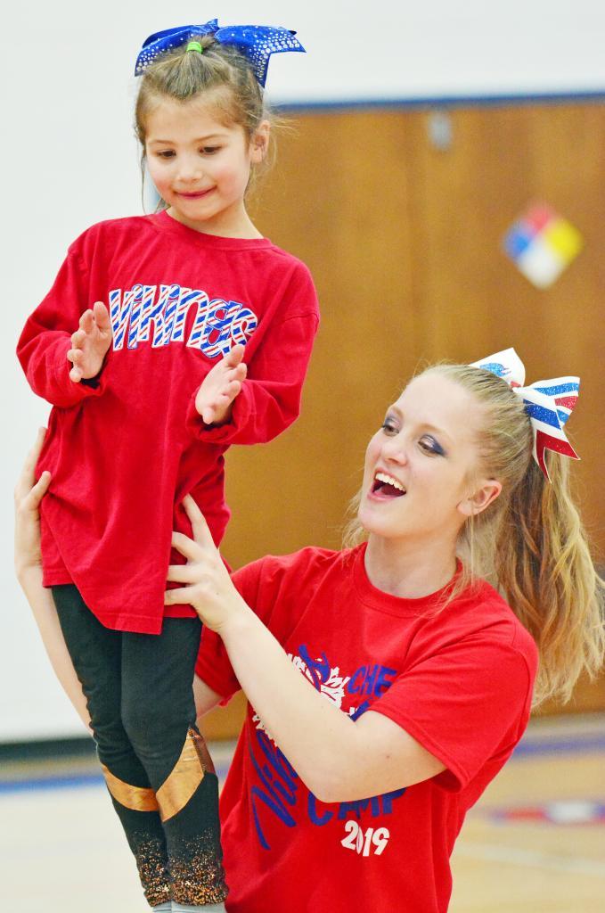 Cheerleader Emily Roskens and Little Cheerleader Jersey Harris.