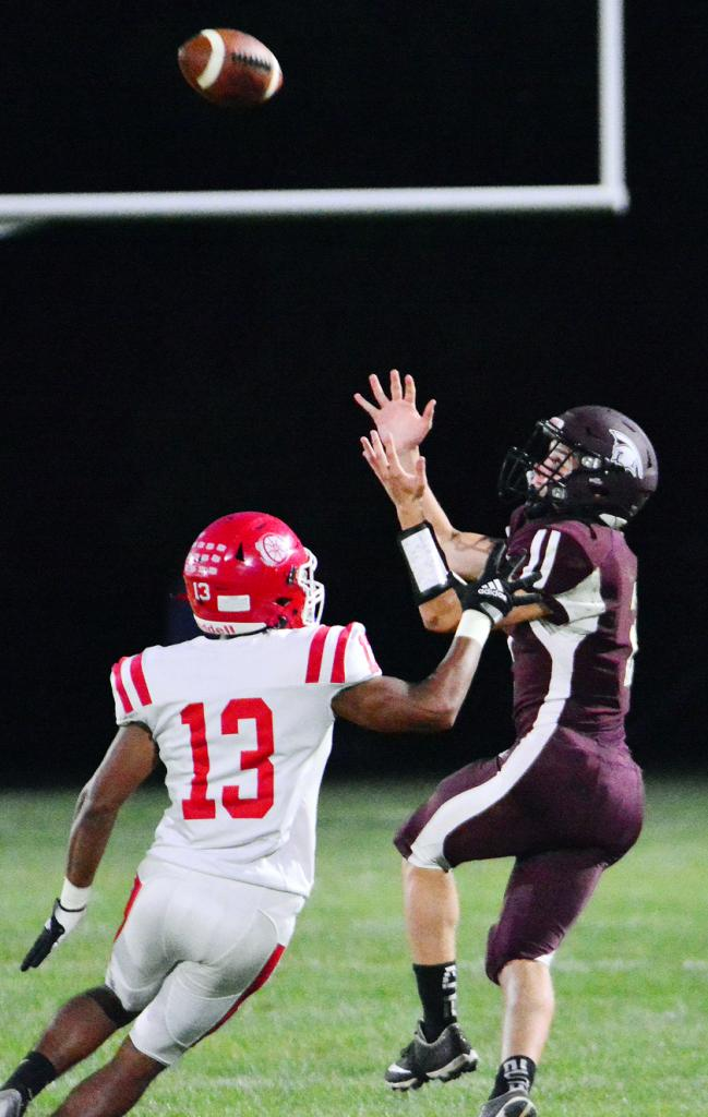 Spartan sophomore Aiden Flathers (right) gets behind Audubon's Matthew Beisswenger for a pass reception.