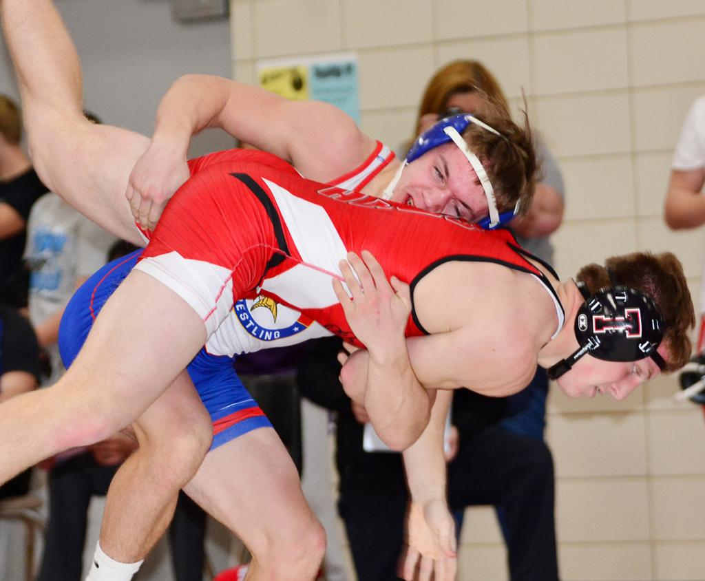 AHSTW 152-pounder Jaedan Rasmussen controls Treynor's Evan Smith in a quarterfinal match at the WIC Wrestling Tournament on December 21. Rasmussen defeated Smith by technical fall and placed second in his bracket.