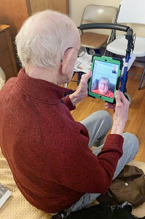 Bud Weis utilizes his Ipad to visit with a family member.  (Photo contributed)