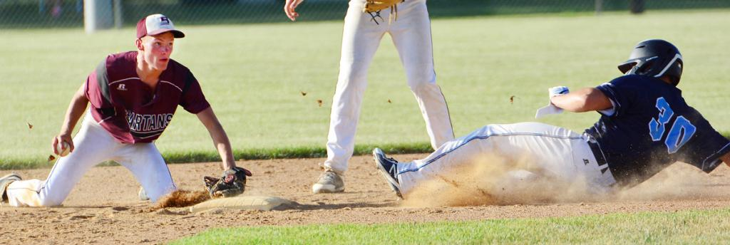 Exira-EHK senior shortstop Cole Burmeister (left) tags the second base bag to force out Panorama's Brice Taylor during Friday's Spartan victory. (Photos by Bob Bjoin)