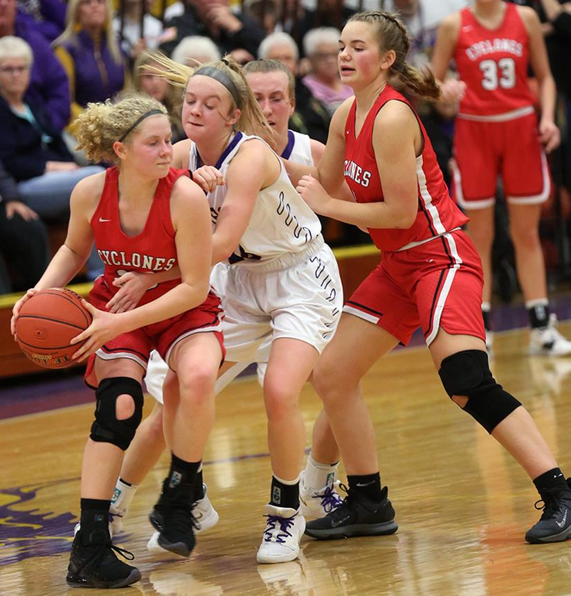 HCHS junior Brecken Van Baale (left) is guarded by Denison's Cambri Brodersen as teammate Jocelyn Cheek looks to set a screen during Tuesday night's Cyclone victory. (Photo courtesy of Todd Danner, Denison Bulletin/Review)
