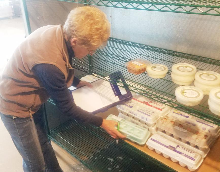 Jo Ann Bargenquast checks the inventory of eggs at FarmTable.