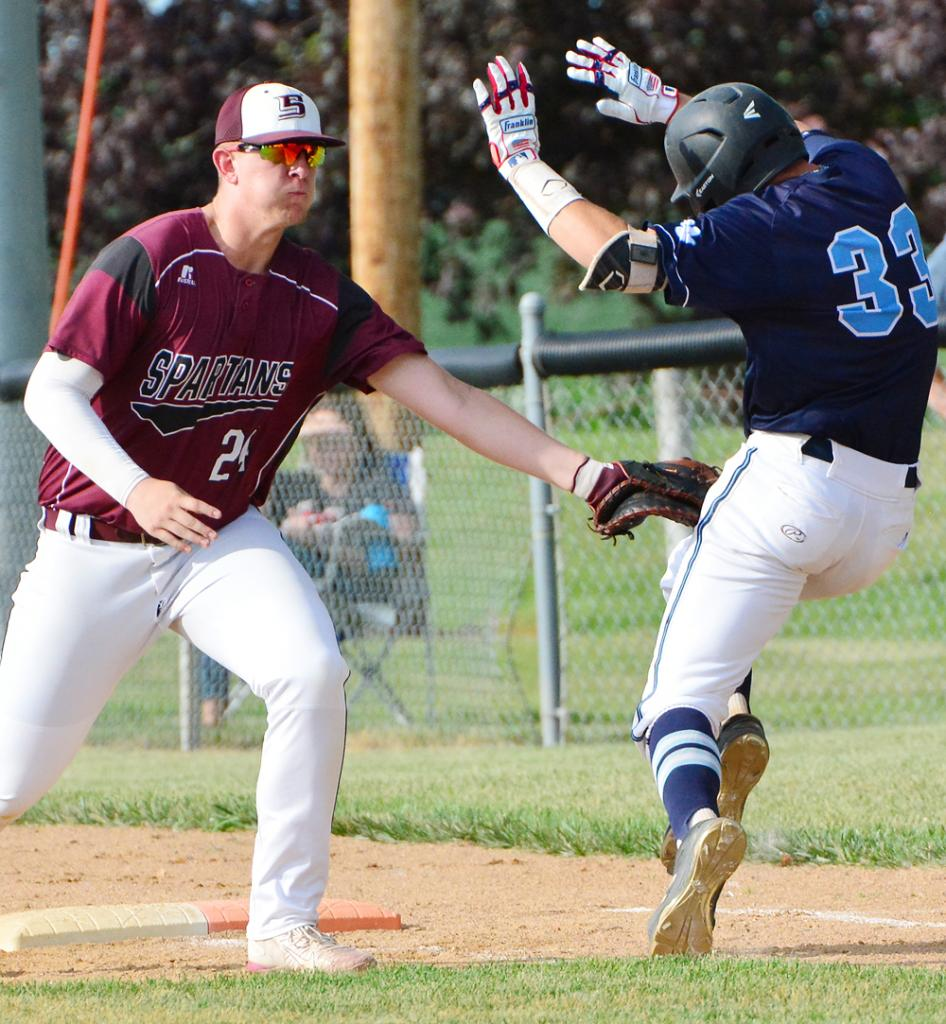 Spartan first baseman Anthony Kingery tags out Drew Taylor of Panorama.