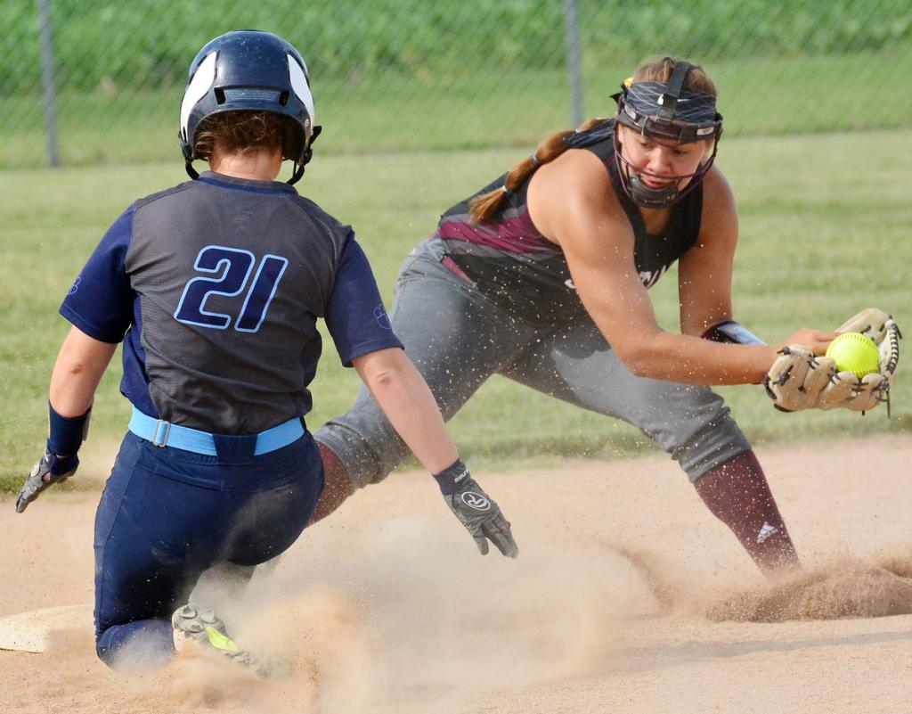 Spartan second baseman Tatum Grubbs receives a throw as Panorama's Hannah Woodworth (21) slides in safely.