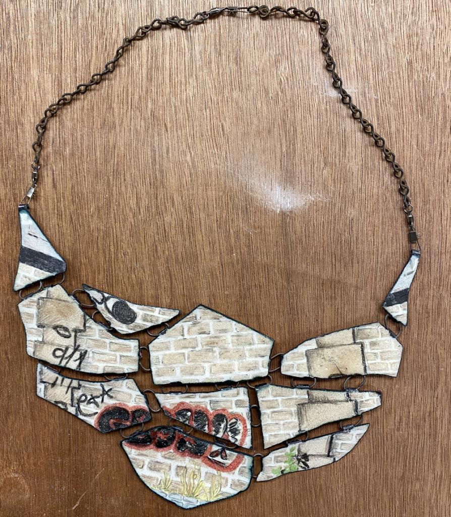 The necklace's design was inspired by a photo she took while in France in 2018.