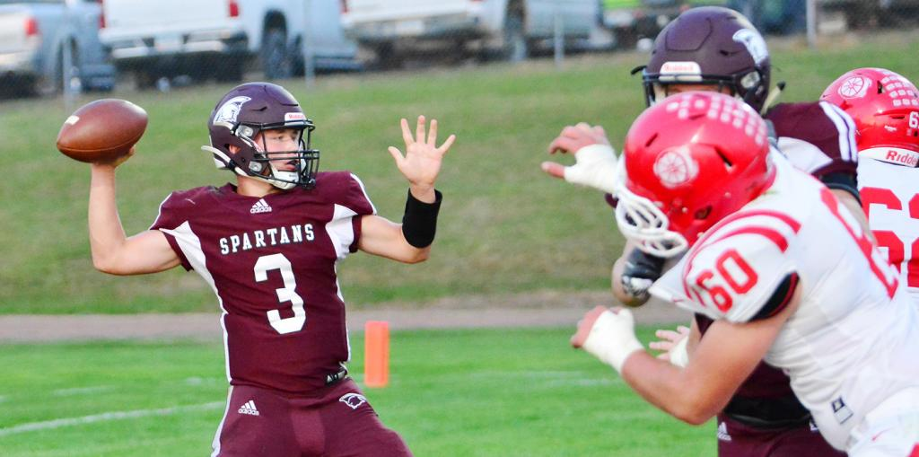 Junior quarterback Trey Petersen of Exira-Elk Horn-Kimballton steps into a throw during Friday's 56-7 home loss against third-ranked Audubon. Petersen threw a touchdown pass to Tyler Kingery for the Spartans' only points of the night. (Photos by Bob Bjoin)
