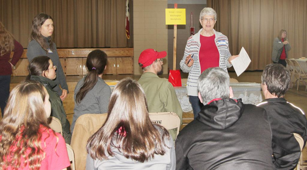 Pat Kenkel talks to a group at the Grove/Union/Washington/Westphalia precinct