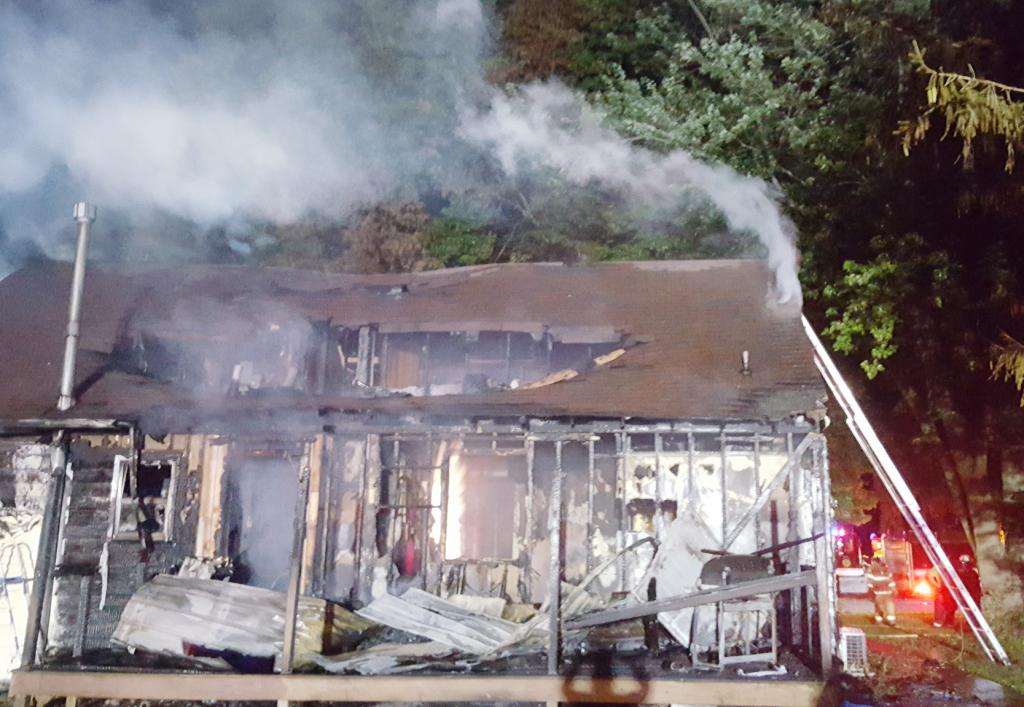 The home at 504 Plateau St. in Shelby was destroyed in a fire during the early morning hours of Thursday, Aug. 29.  Firefighters battled the blaze during a heavy thunderstorm.  All occupants of the home were able to escape and were unharmed.  (Photo contributed)