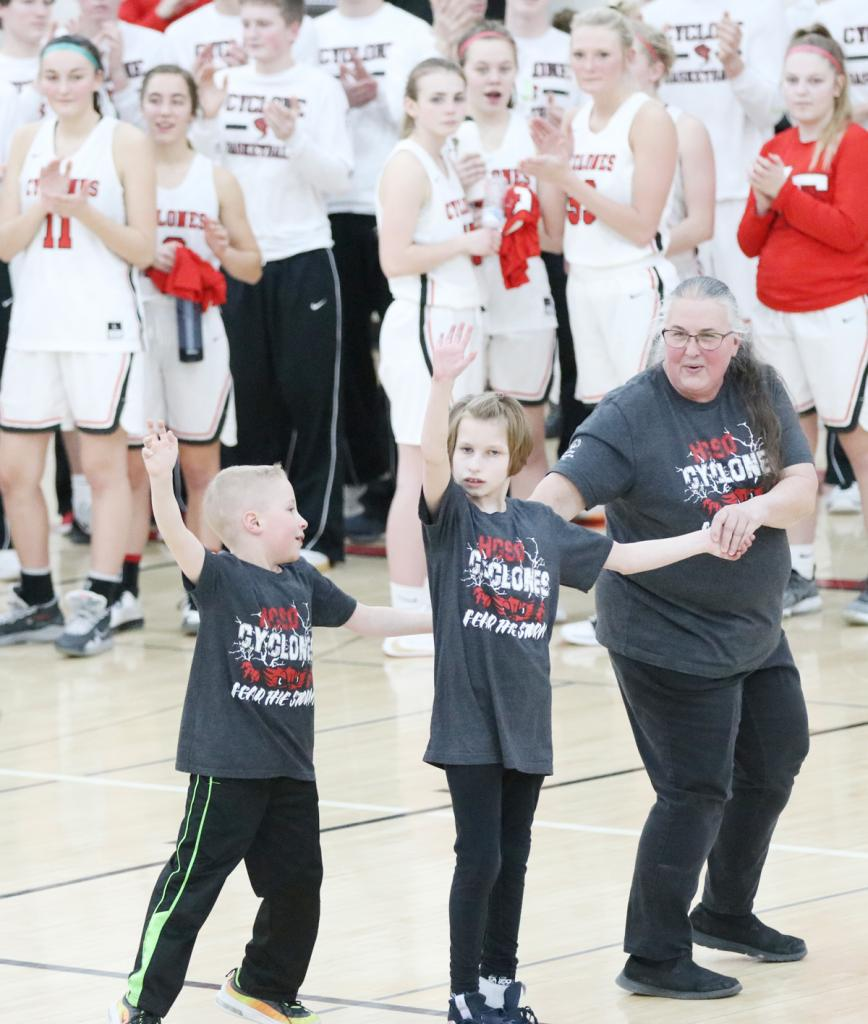 The girls basketball team cheers for those performing, including Orion Dillon and Johanna Gross with teacher Eva Laver.