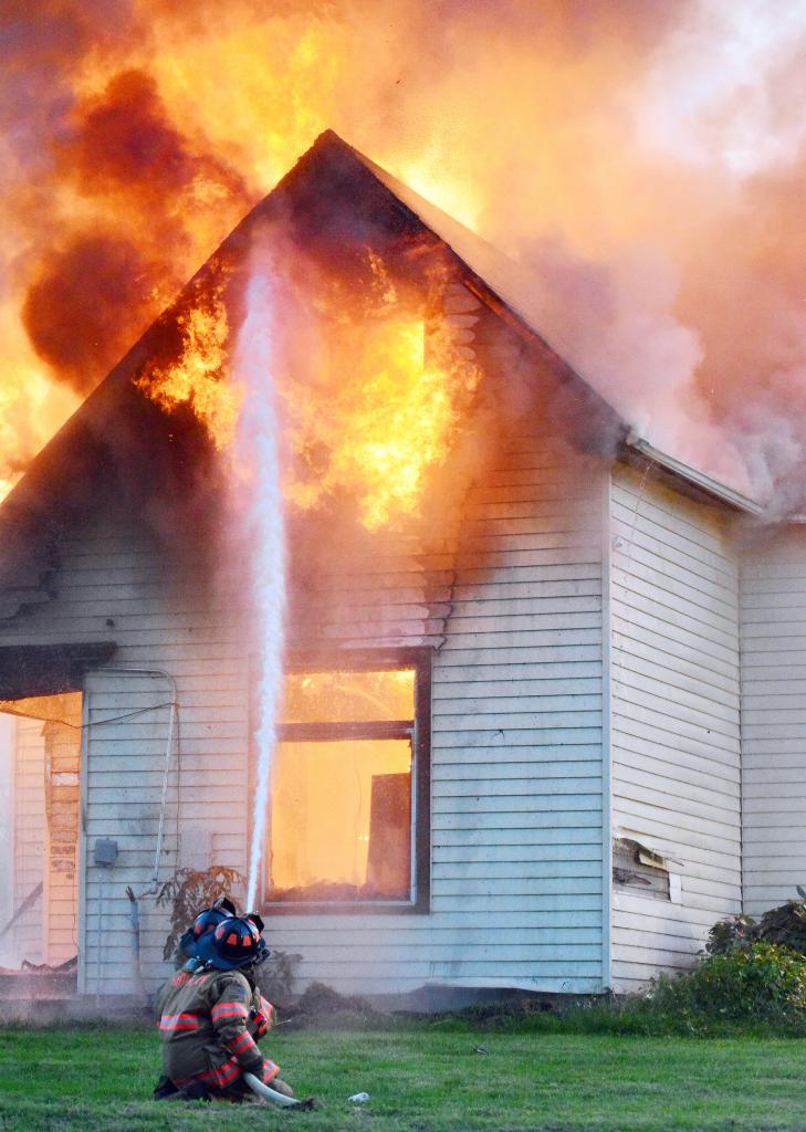 Harlan firefighters keep a blaze in north Harlan under control Monday evening, August 26.