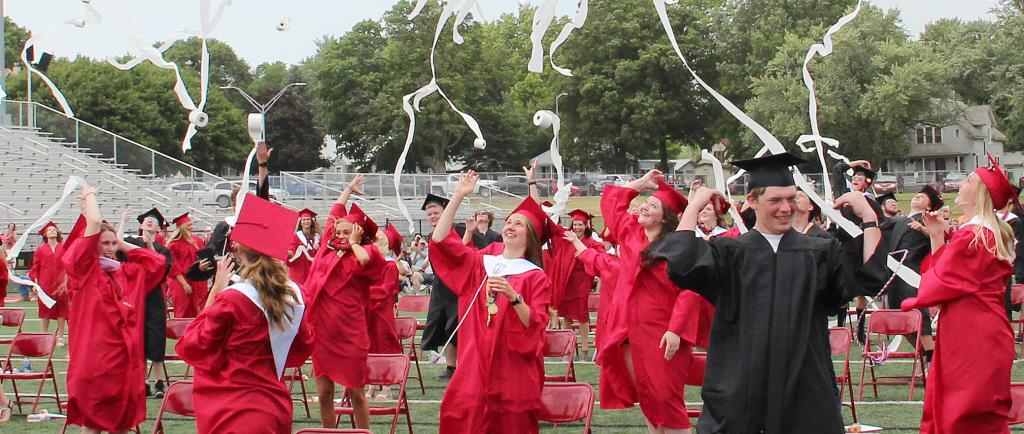 Graduates throwing toilet paper into the area after being presented.