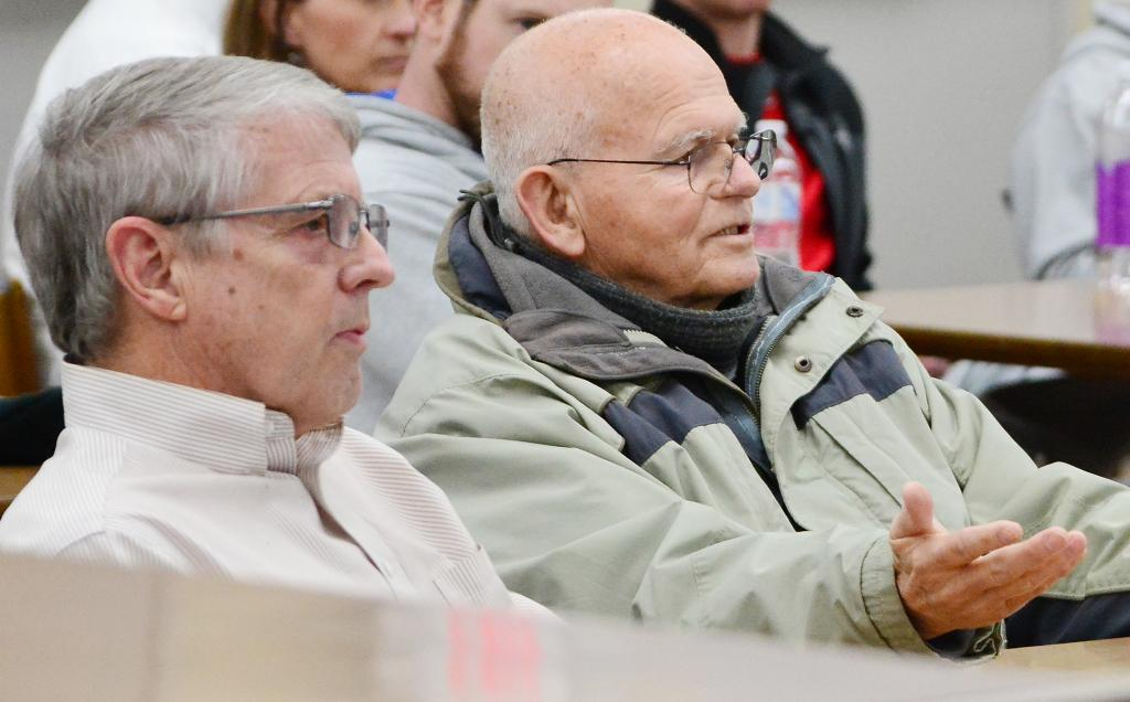 Harlan citizen Larry Trickel (right) has been an outspoken critic of the Wagner investigation and school board for months.  He spoke again Monday night, but the board has now said it's done dealing with him.  Listening to Trickel speak is Larry Hopp.