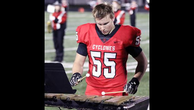 Allen Fries is a starting defensive end on the varsity football team as well as the section leader for the pit in the marching band.  He's one of the first students in years to participate in both activities on game night Fridays.