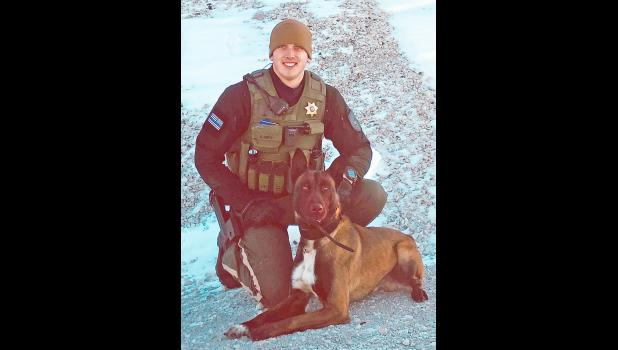 Officer Braden Quist with K9 Corty.