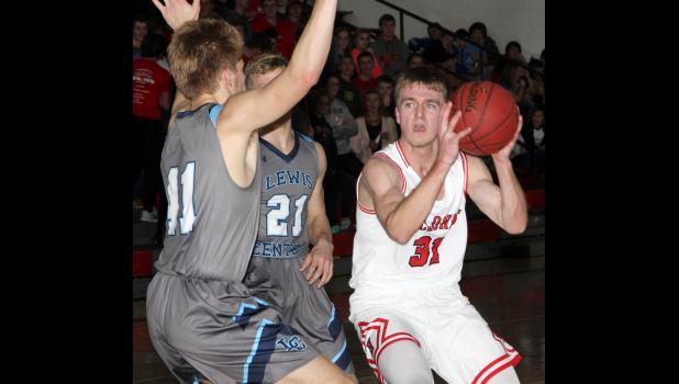 HCHS senior Shane Chamberlain (31) led the Cyclones with 18 points in Friday night's win over Lewis Central.