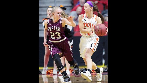 Exira-EHK sophomore Ellie Schultes (23) defends Springville senior Rylee Menster on the perimeter.