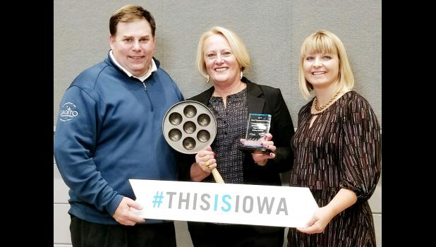 Accepting the award was Lisa Riggs, manager, Danish Windmill, from Director of Tourism Shawna Lode (right) and President of Travel Federation of Iowa Andy Milam (left).