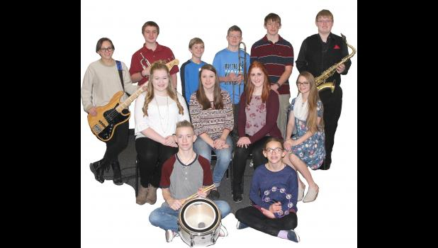 Faith Sound members include front L to R -- Kaleb Ask and Evelyn Schechinger.  Middle L to R -- Katelyn Kluver, Emily Ask, Caitlin Bissen and Emily Taggs.  Back L to R -- Emma Schechinger, Griffin Schleimer, David Kluver, Eli Arnold, Samuel Andersen and Gabe Madson.  Missing are Emma Herzberg, Camron Buck, Joseph Andersen, Ashley Knudtson, Emma Barnes and Jessalyn Schleimer.